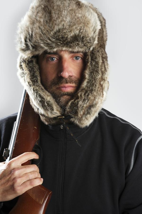 Download Hunter Winter Fur Hat Man Holding Gun Stock Photo - Image: 14181002