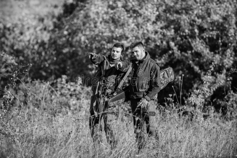 Hunters friends enjoy leisure. Hunters with rifles in nature environment. Poacher partner in crime. Activity for real royalty free stock photos