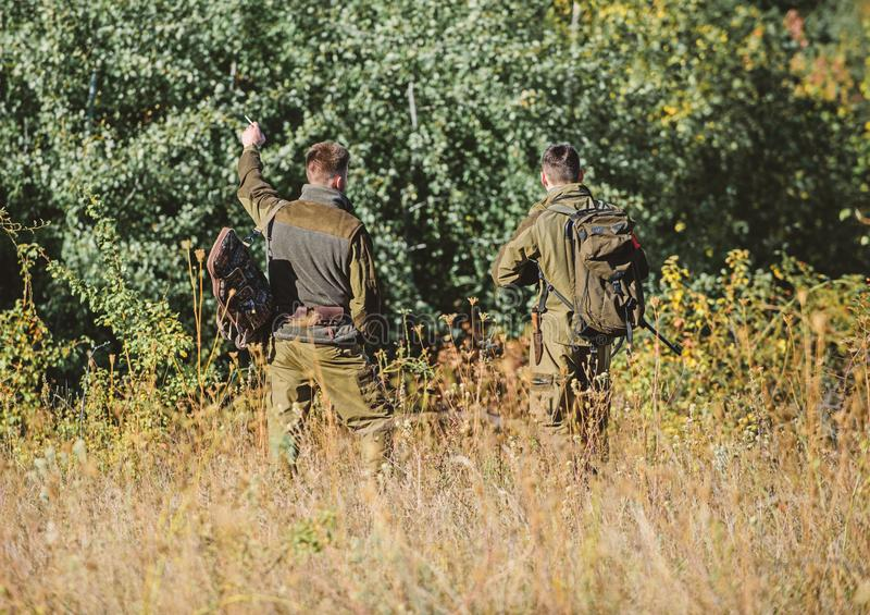 Hunters gamekeepers looking for animal or bird. Hunting with friends. Hunters friends enjoy leisure. Teamwork and stock photos
