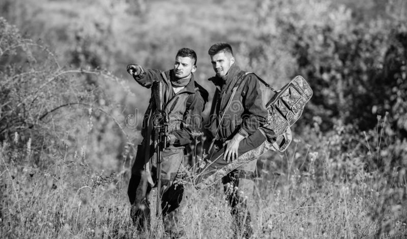 Hunters with rifles in nature environment. Poacher partner in crime. Activity for real men concept. Hunters gamekeepers stock images