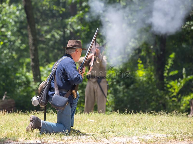 American Civil War Battle Reenactment. HUNTERSVILLE, NC - JUNE 1, 2019 USA:  Reenactors in Confederate and Union army uniforms recreate an American Civil War stock images