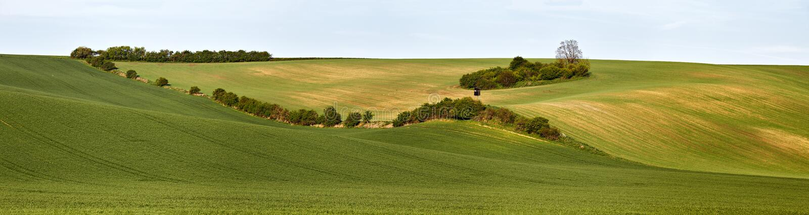 Hunting box in Green spring hills. Arable lands in Czech Moravia. April royalty free stock photo