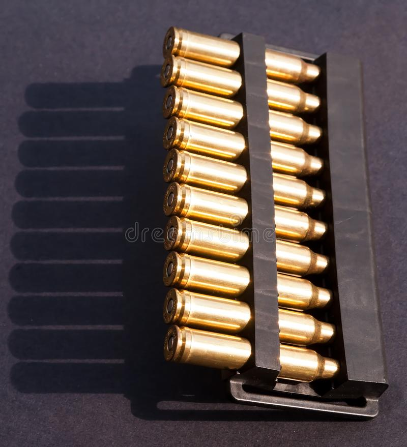 Hunting bullets in a case on a black background royalty free stock image