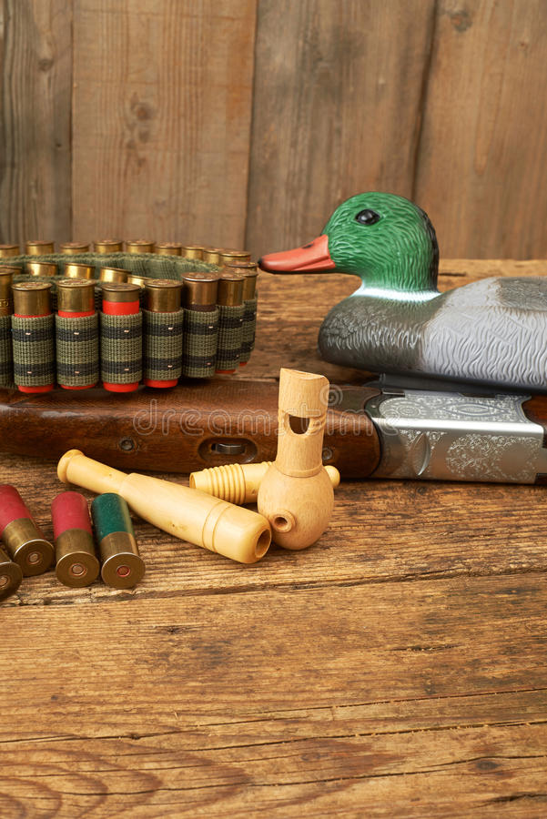 Hunting.Duck decoys with wooden whistles. Hunting. Duck decoys and wooden whistles stock photo