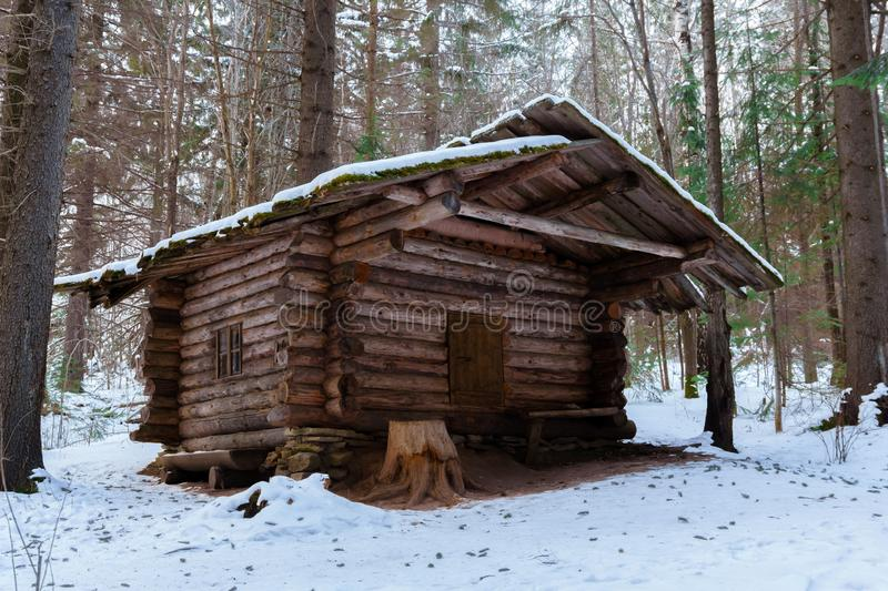 Hunting hut in the winter forest royalty free stock photography