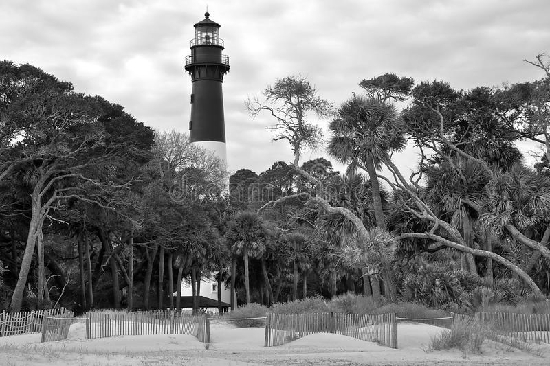 Hunting Island South Carolina Lighthouse. Photographed from the beach in black & white against a cloudy sky stock images
