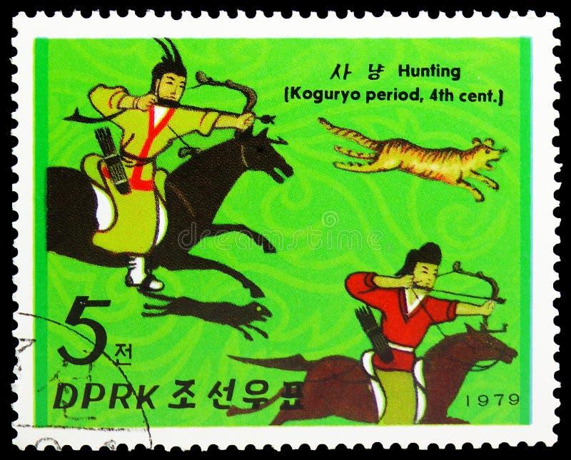 Hunting, Koguryo Dynasty Horsemen serie, circa 1979. MOSCOW, RUSSIA - MAY 25, 2019: Postage stamp printed in Korea shows Hunting, Koguryo Dynasty Horsemen serie stock image