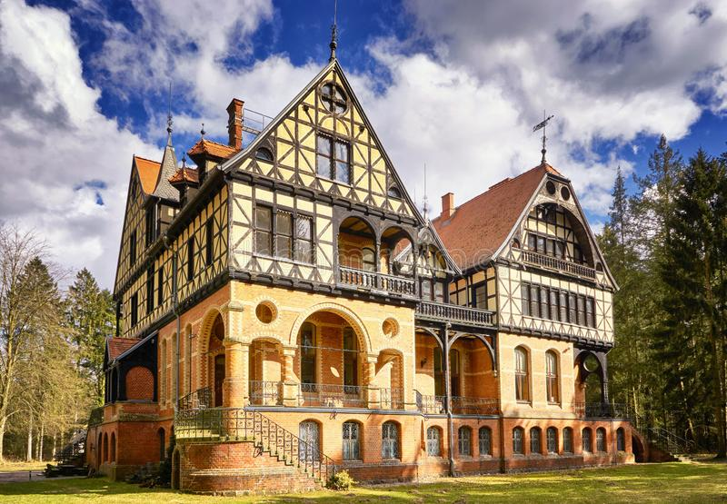 Hunting lodge under sky with clouds in the forest in yellow sands. Gelbensande, Germany. Castle, building, woods, warnemuende, rostock, old, romantic stock photos