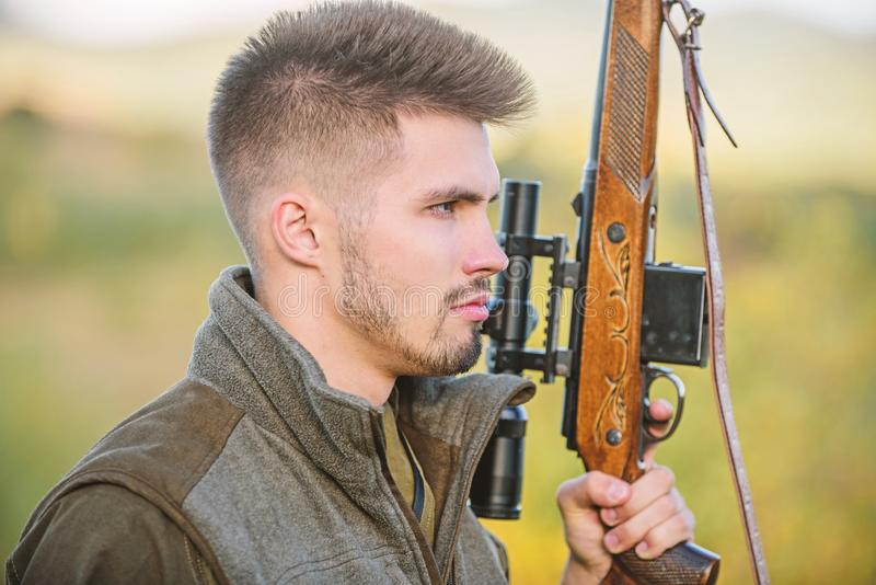 Hunting masculine hobby concept. Man brutal gamekeeper nature background. Regulation of hunting. Hunter hold rifle royalty free stock image