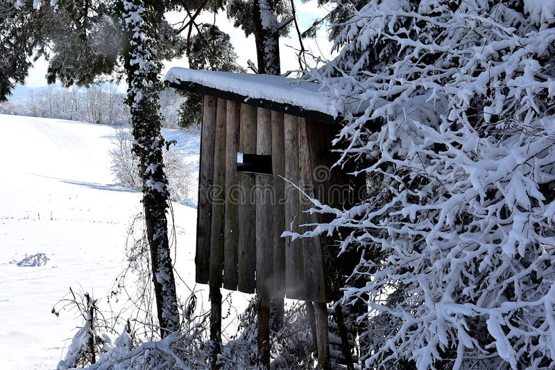 Hunting observatory. Old hunting observatory in snowy landscape royalty free stock photography