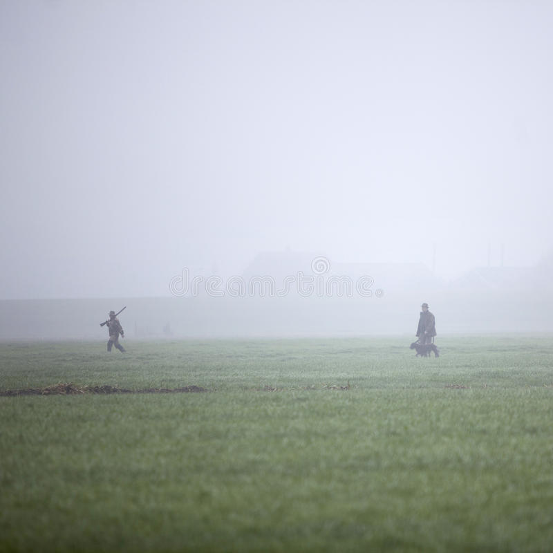 Hunting party in meadow in the Netherlands. Hunting party in meadow in holland under misty conditions stock images