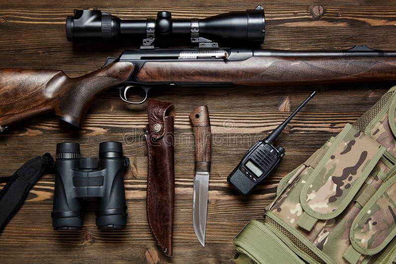 Lovačko oružje i municija - Page 4 Hunting-rifle-ammunition-dark-wooden-background-top-view-hunting-rifle-ammunition-wooden-background-111296470