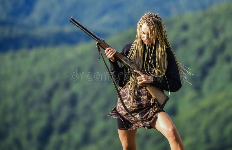 Hunting season. Sexy warrior. She is warrior. Woman attractive long hair pretty face hold rifle for hunting. Dangerous. Girl. Defending concept. Warrior royalty free stock photos