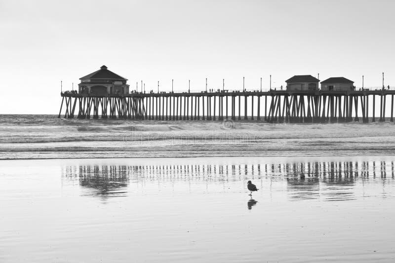 Huntington Beach Pier At Dusk Against A Sunset Stock Photo