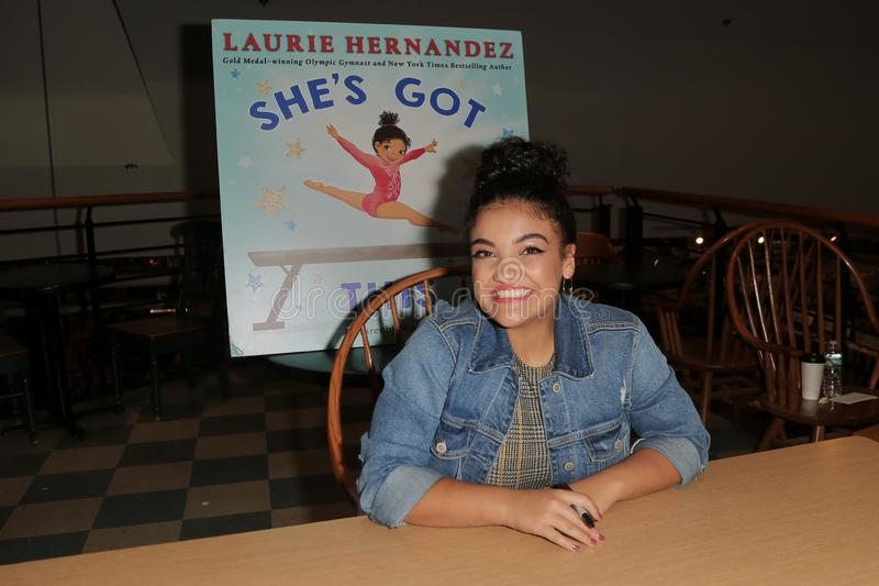 Laurie Hernandez. HUNTINGTON, NY - OCT 11: Olympian Laurie Hernandez signs copies of her book `She`s Got This` at Book Revue on October 11, 2018 in Huntington royalty free stock images