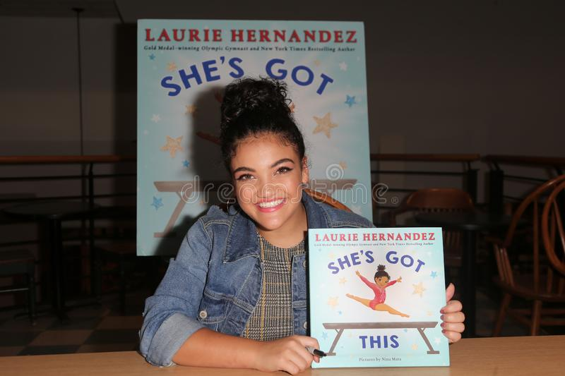 Laurie Hernandez. HUNTINGTON, NY - OCT 11: Olympian Laurie Hernandez signs copies of her book `She`s Got This` at Book Revue on October 11, 2018 in Huntington stock image