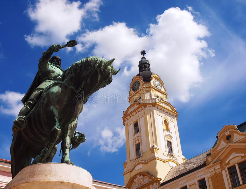 Hunyadi statue and Clock Tower, Pécs, Hungary royalty free stock photography