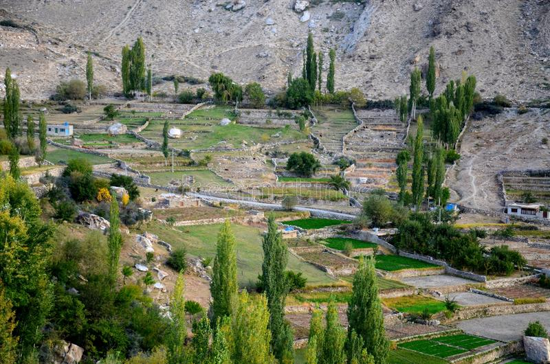 View of village and fields in Hunza Valley northern Pakistan stock photos