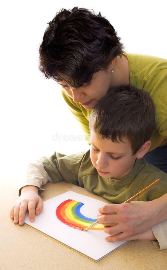hur målarfärgregnbåge till arkivbild