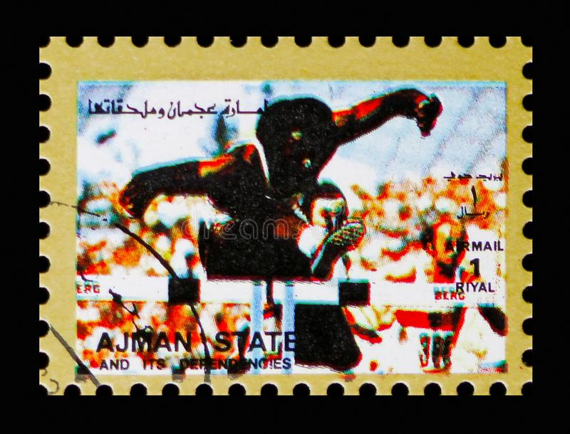 Hurdle race, Summer Olympics serie, circa 1973. MOSCOW, RUSSIA - NOVEMBER 10, 2018: A stamp printed in Ajman shows Hurdle race, Summer Olympics serie, circa 1973 royalty free stock image