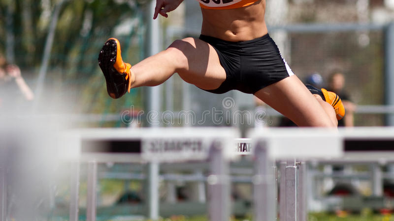 Hurdles sprint. Sprint start in track and field stock photos