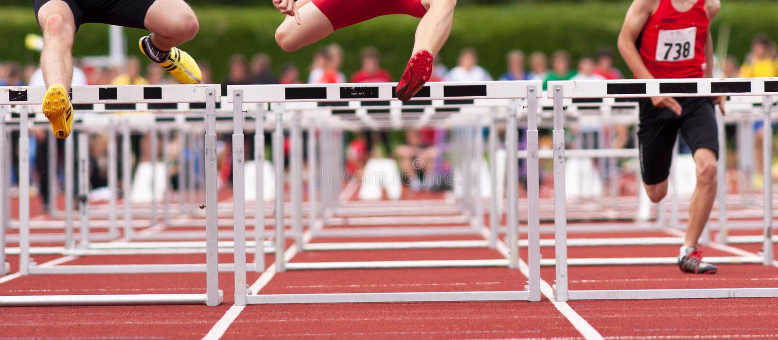 Hurdles sprint in track and field. Athletes in hurdles sprint in track and field stock photography