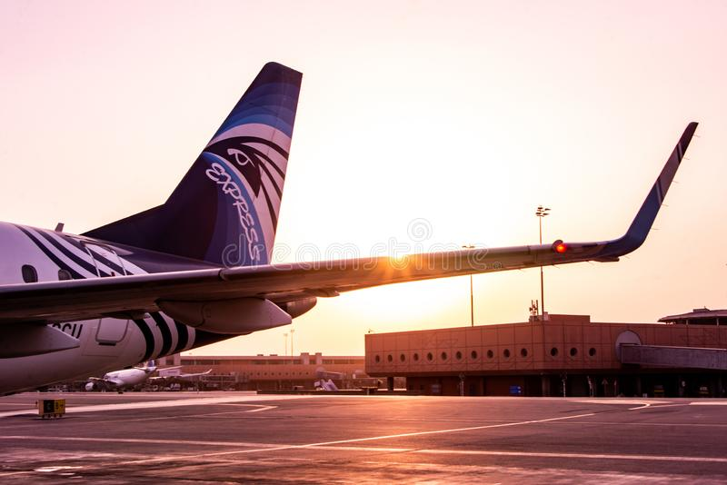 HURGHADA EGYPT 26.05.2018 - Egypt Air Airplane standing to parking position during sunset over its wing stock images