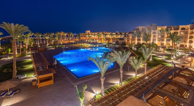 Hurghada / Egypt - July 12, 2019: Night view of the the yard, bars, pool and beach in hotel Continental stock images