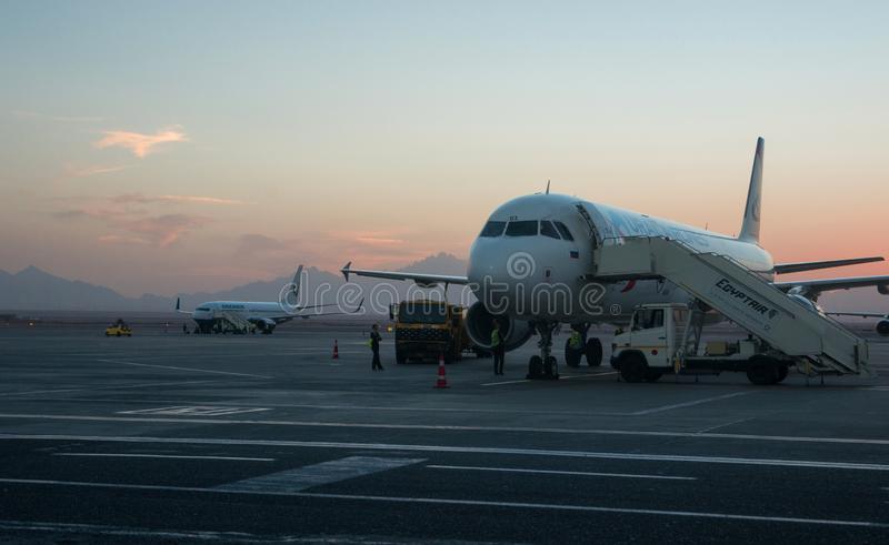 Passenger planes of the Russian airlines Uralairlines and Orenair are waiting for passengers to load at the airport of Hurghada. royalty free stock photography