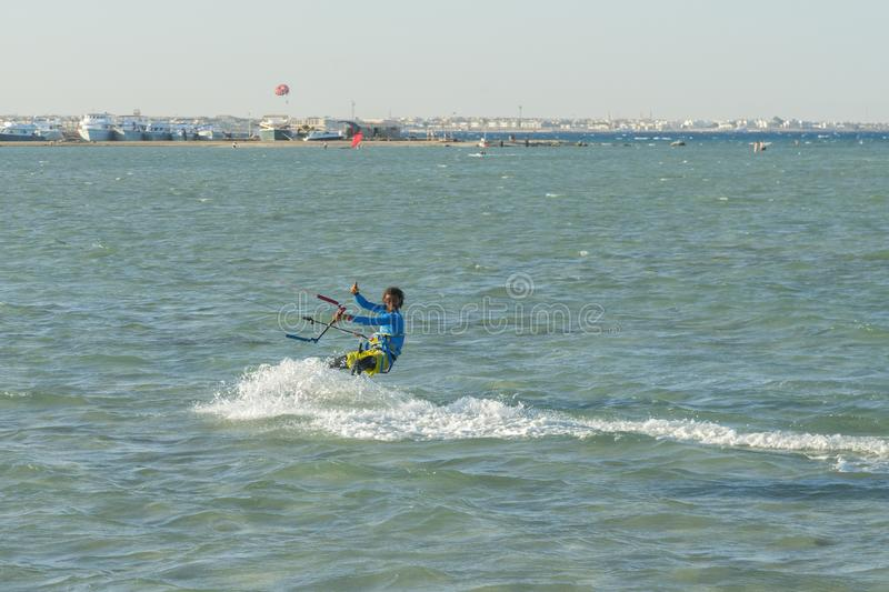 Hurghada, Egypt. November 19 2018 Kitesurfing Kiteboarding action photos man among waves quickly goes. A kite surfer rides the. Waves stock images