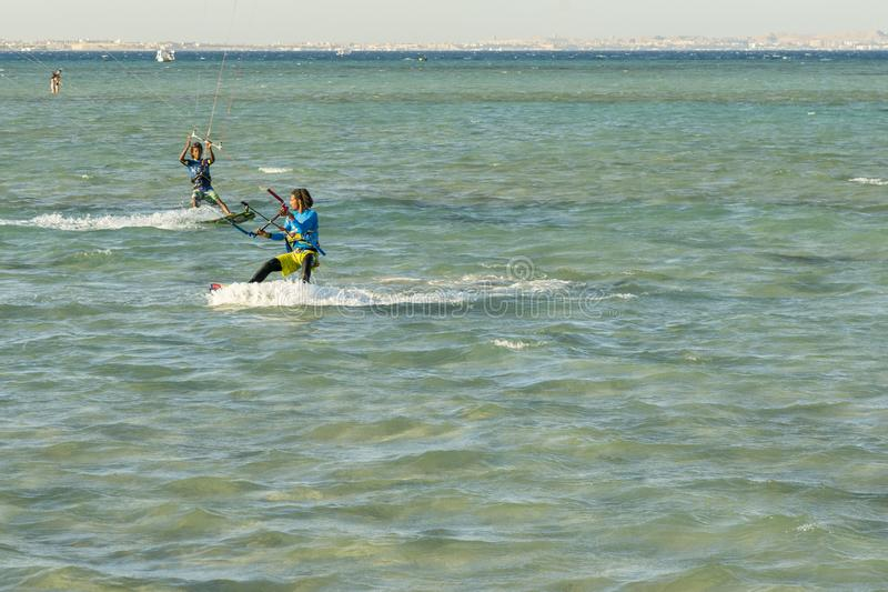 Hurghada, Egypt. November 19 2018 Kitesurfing. Man rides on kite on waves. Kitesurfing Kiteboarding action photos mans among waves. Quickly goes royalty free stock photos