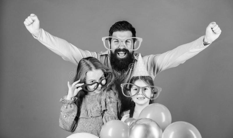 Hurray. Happy family celebrating birthday party. Family party. Family of father and daughters wearing party goggles. Father and girl children enjoying party stock photos