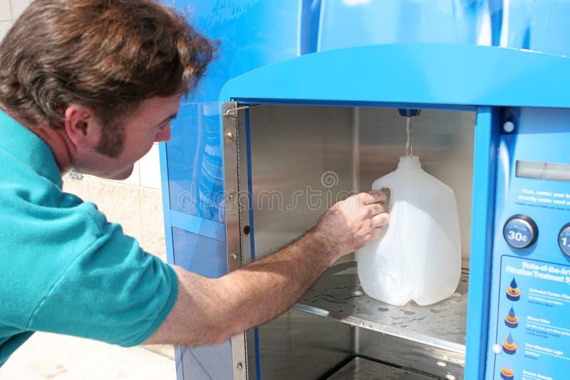 Hurrican Preparedness - Filling Water Bottle royalty free stock image
