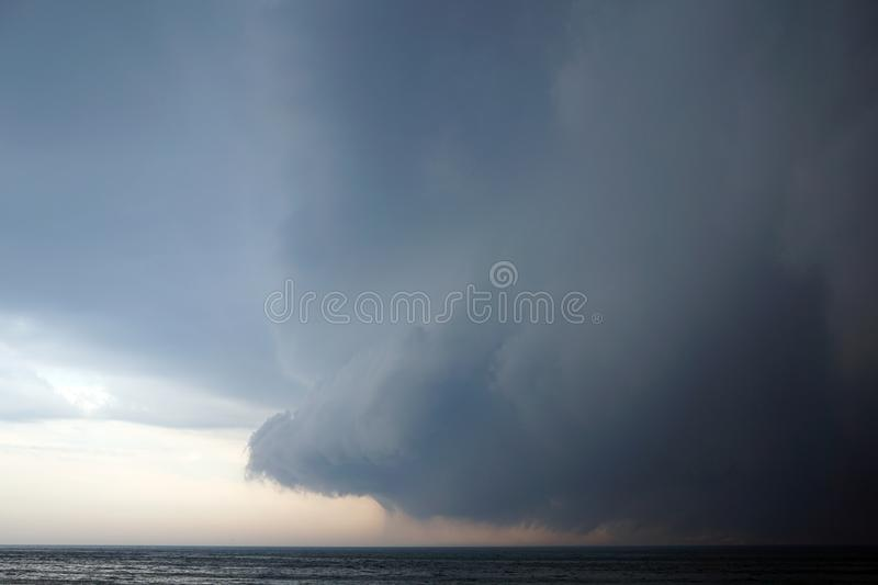 Hurricane with Dark clouds coming with the storm over the Michigan lake stock image