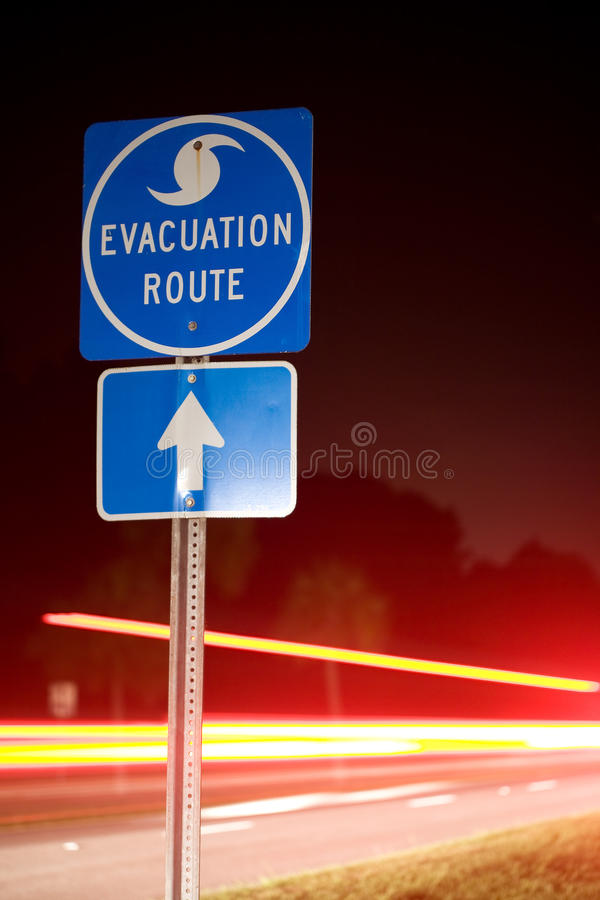 Hurricane Evacuation Route. Speeding cars flee an impending storm at night along a hurricane evacuation route stock photo
