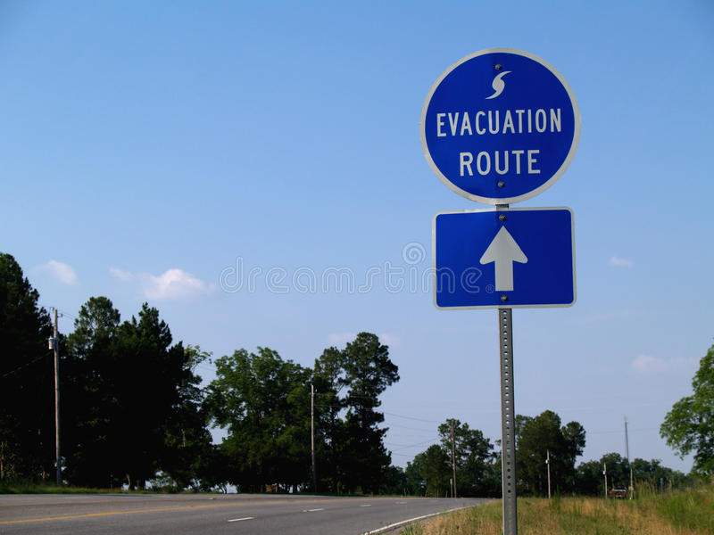 Hurricane Evacuation Route Sign. Blue hurricane evacuation route sign along a highway royalty free stock photography