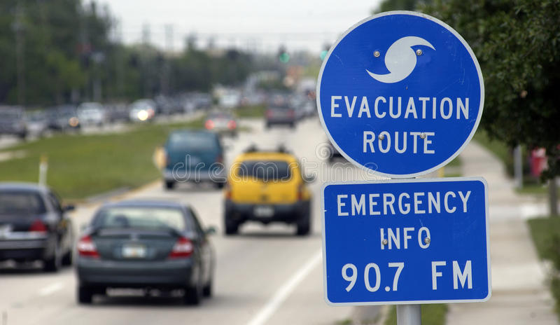 Hurricane evacuation sign. On highway with cars driving away in background, Florida, U.S.A stock image