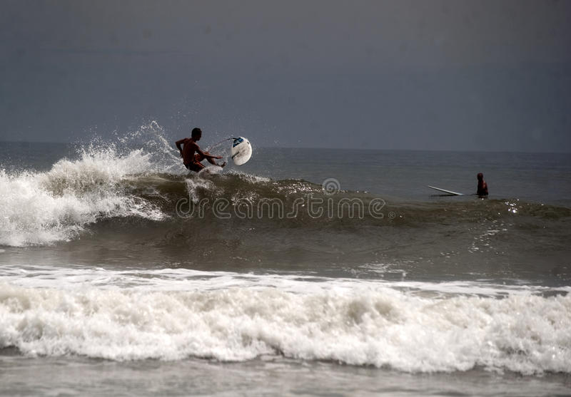 Hurricane Irene. Surfers surf on the rough waters off Assateague Island National Seashore Friday before the beaches closed for Hurricane Irene Friday 8/26/2011 royalty free stock images