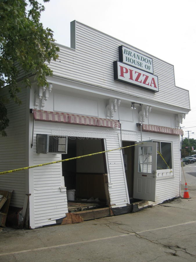 Hurricane Irene. Hit the little town of Brandon, Vermont with such massive flooding as to move the pizza shop off it's foundation and what was left was in the stock images