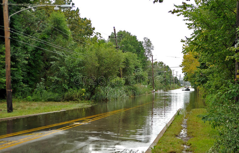 Hurricane Irene aftermath in the Philadelphia area. BENSALEM, PA - AUGUST 28: State Road is blocked by standing water in the roadway and an abandoned vehicle in royalty free stock images