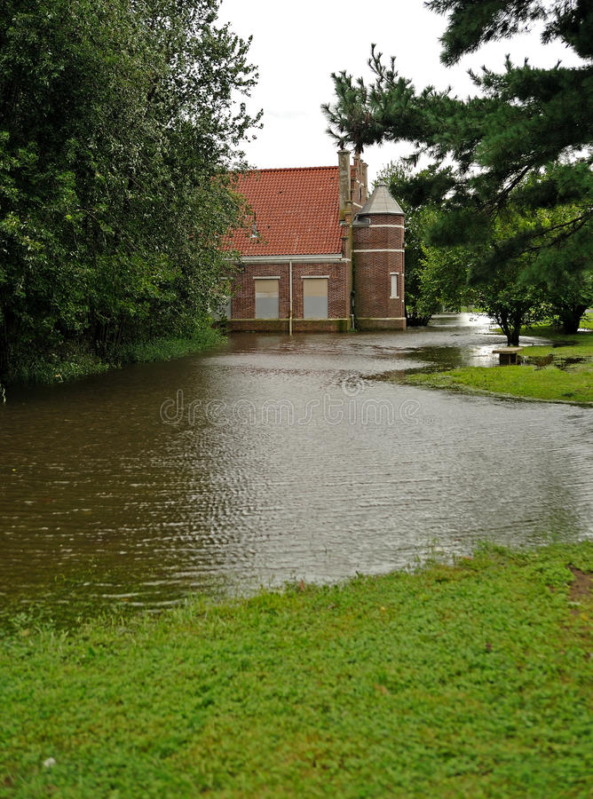 Hurricane Irene aftermath in the Philadelphia area. PHILADELPHIA - AUGUST 28: A building in a park in Northeast Philadelphia is surrounded by water in flooding stock photos