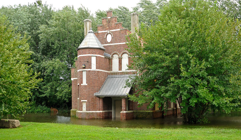 Hurricane Irene aftermath in the Philadelphia area. PHILADELPHIA - AUGUST 28: A building in a park in Northeast Philadelphia is surrounded by water in flooding royalty free stock images