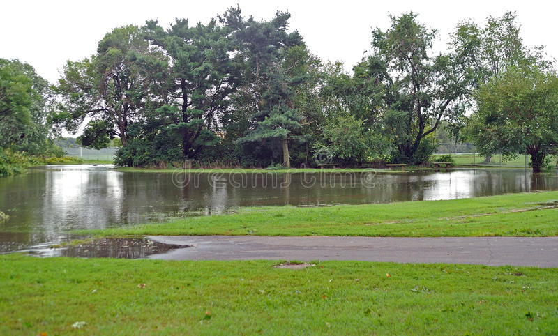 Hurricane Irene aftermath in the Philadelphia area. PHILADELPHIA - AUGUST 28: A road in a park in Northeast Philadelphia is blocked by flood waters caused by royalty free stock photo