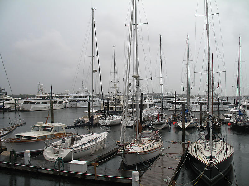 Hurricane Irene Boats Moored in Boston Harbor. Hurricane Irene approaching downtown Boston and Boston Harbor with dark clouds and downpours. Boats in the harbor stock photography