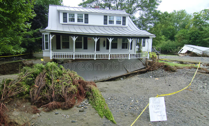 Hurricane Irene Destroyed home. A home near Royalton Vermont that survived Hurricane Irene only to have the road and yard washed out royalty free stock photography