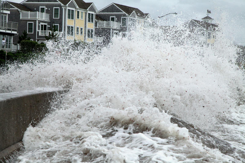 Hurricane Irene waves breach seawall. Waves from Hurricane Irene breach the seawall at Narragansett Town Beach and get very close to the condos across the street royalty free stock photo