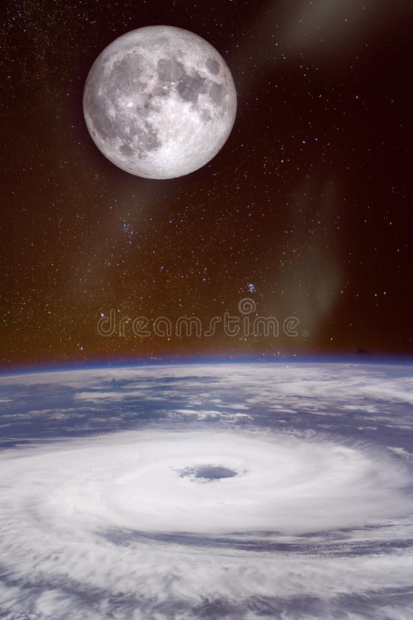 Hurricane over the ocean with full moon in background stock photography