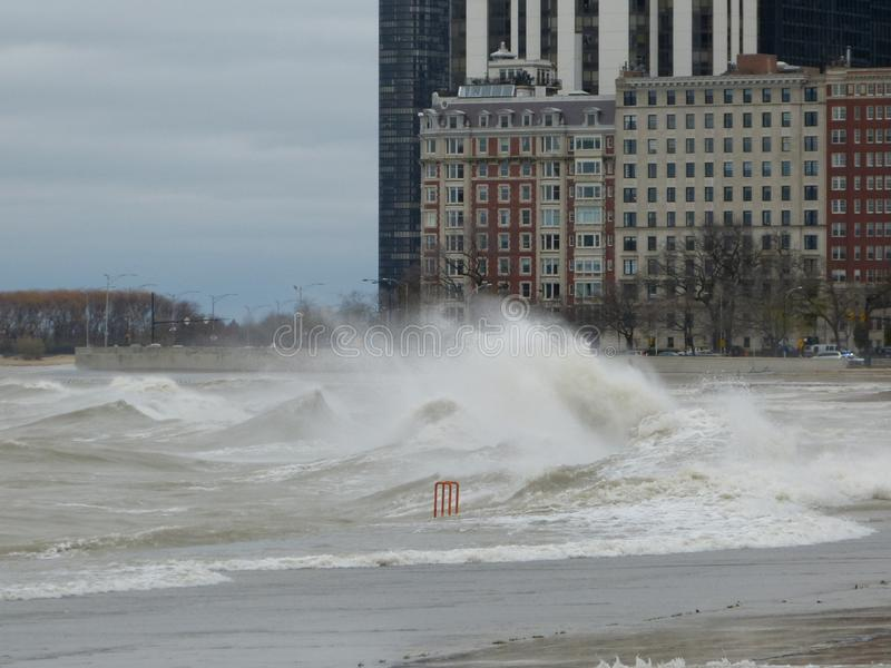Hurricane Sandy causes the Lake Michigan to rise outside its shore. The Hurricane Sandy in 2012 causes unrest in the Lake Michigan in Chicago stock photography