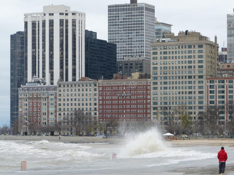 Hurricane Sandy causes the Lake Michigan to rise outside its shore. The Hurricane Sandy in 2012 causes unrest in the Lake Michigan in Chicago stock image