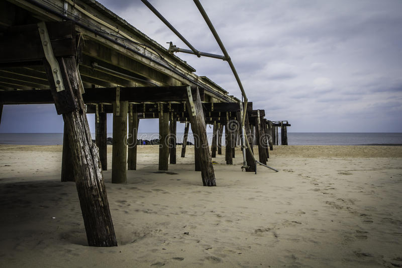 After Hurricane Sandy: Ocean Grove, New Jersey Fishing Pier. The ruins of the Ocean Grove Fishing Pier approximately three months after Hurricane Sandy destroyed stock image